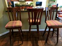Three bar height stools. Bassett. Reddish wood Clarksburg, 20871