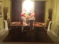 Dining room table comes with 6 chairs and a extended table piece.  Lansing, MI, USA