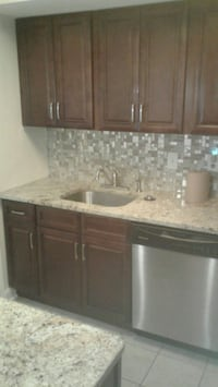 brown wooden kitchen cabinet with sink Hyattsville, 20783