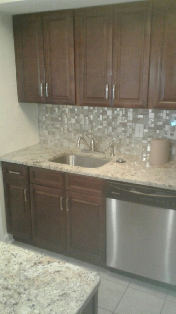 brown wooden kitchen cabinet with sink