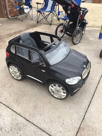 Child's BMW power wheels. Just needs a battery