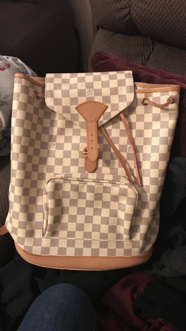 brown and white checkered Louis Vuitton leather backpack