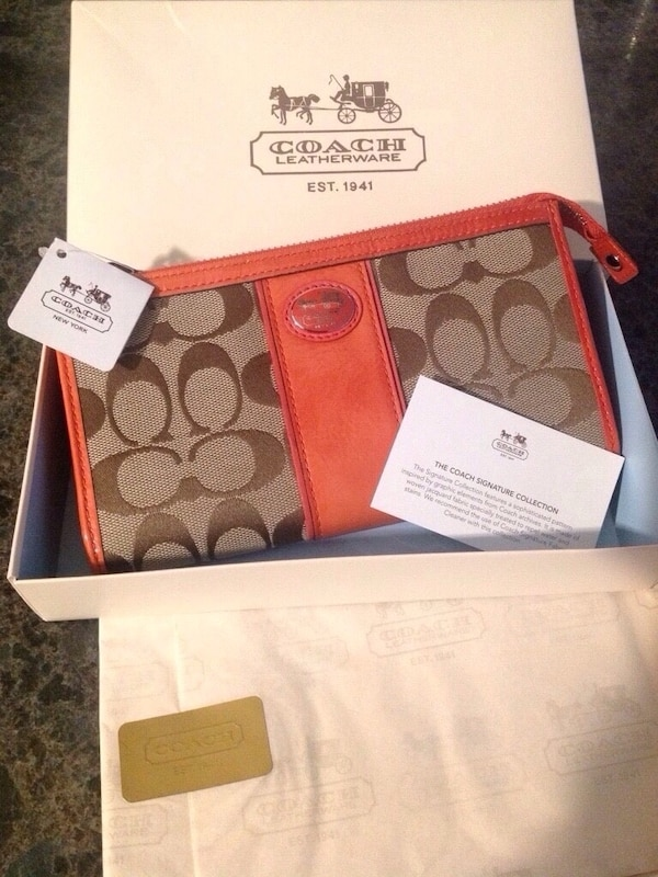 b01eb6092541 Used Coral & Tan Signature Coach Wristlet Wallet for sale in Orange - letgo