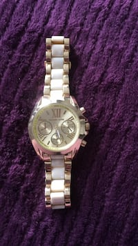 round silver chronograph watch with silver link bracelet Barrie, L4M 0K5