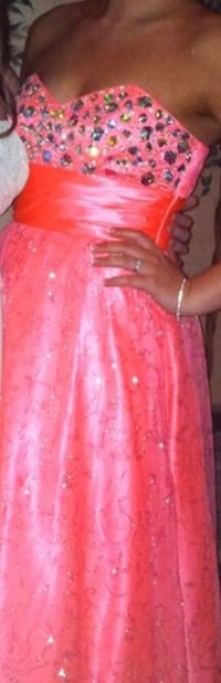 Gorgeous, strapless, full length, sparkling coral gown.