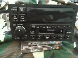 Black 1-din car stereo head unit