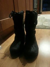 pair of black duck boots