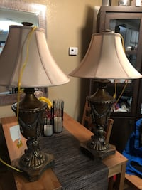 Two brown and cream table lamps