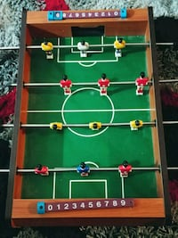 green and brown foosball table