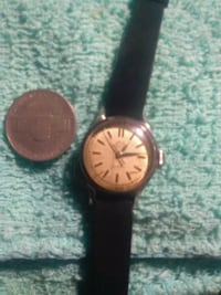 round gold-colored analog watch with black leather strap Tucson, 85743