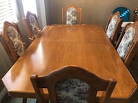 Brown wooden dining table set Abbotsford, V2T 5M6