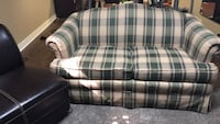 gray and green plaid fabric loveseat