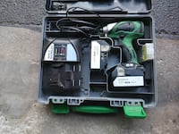 green and black cordless power tool in case Lemont, 60439