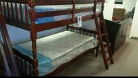 Twin over twin bunk bed with two mattresses (new in the box)