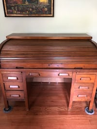 Brown wooden roll top desk $400 or OBO. Will help with delivery within a 25 miles radius.  Dumfries, 22025
