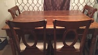brown wooden table with chairs Fayetteville, 72704