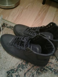 pair of black high-top sneakers