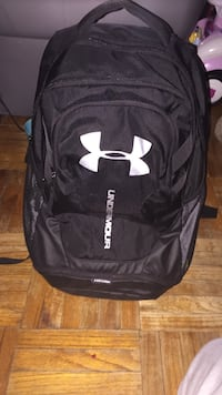 black and white Under Armour backpack