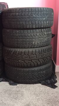 Four black winter tire with rims