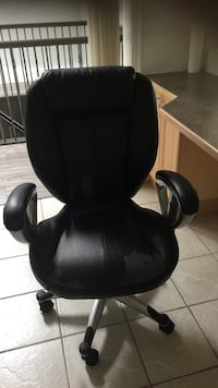 black leather office rolling armchair Burnaby, V5J 2C7