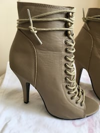 pair of women's gray leather peep-toe heeled booties Calgary, T2W
