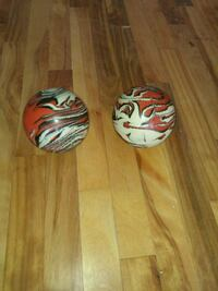 two white-and-red bowling balls Montreal, H1G 2A3