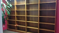 brown wooden display shelves Montréal, H2Y 2A5