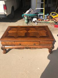 brown wooden framed glass top coffee table Bakersfield, 93306
