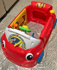 red and white Fisher Price ride-on toy car Woodbridge, 22191