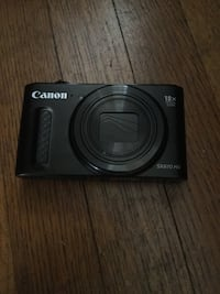 black Canon SX610 HS point-and-shoot camera