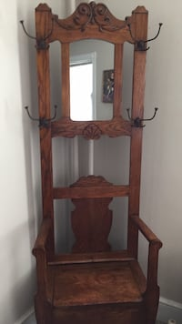 "Attractive Oak Antique Hall rack with ample storage space under pull up seat original hardware hooks and beautiful carving. Great clear mirror and sturdy piece. Measures 74""Hx24""Wx21""D. Priced to Sell  49 km"