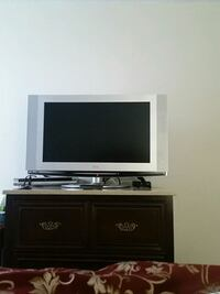 black flat screen TV with black wooden TV stand London, N6C 4N1