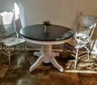 round white wooden pedestal table with two chairs Queen Creek, 85143