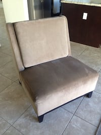 brown fabric padded armless chair Las Vegas