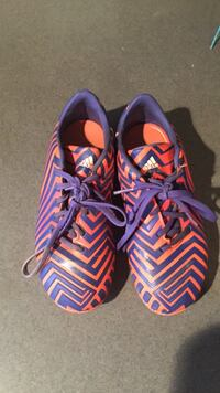 Kids blue and orange adidas soccer shoes cleats
