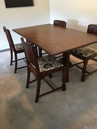 rectangular brown wooden table with four chairs dining set Clearwater, 33763