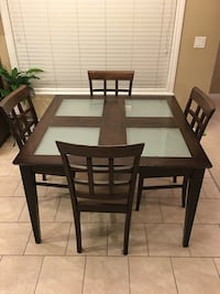 Rectangular black wooden table with four chairs dining set Surrey, V3S 7A6