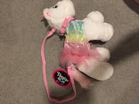 Unicorn purse. Tags on