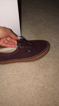 unpaired brown Vans low-top sneaker