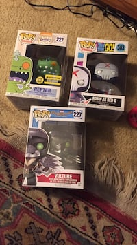 three Pop! Rugrats, Teen Titans Go!, and Marvel Spiderman 583 and two 227 Reptar, Vulture, and Robin as Red X vinyl figure boxes