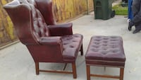two brown wooden framed padded armchairs 2274 mi