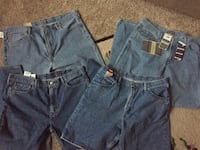 two blue and black denim jeans 33 km