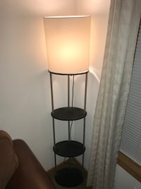 black metal base with white shade floor lamp