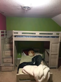 Loft bed with desk , sectional couch and  pool table