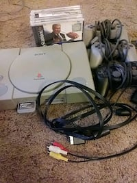 black Sony PS1 console with controller