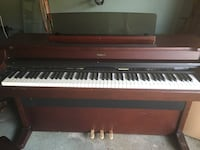 brown and white upright piano Commack, 11725