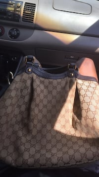 brown and black Gucci leather tote bag Baltimore, 21209