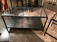 Rectangular black metal framed clear glass top coffee table