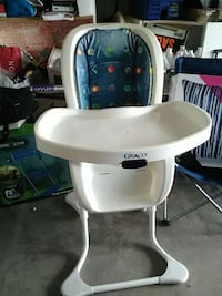 baby's white and blue Graco highchair with tray Apopka