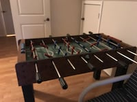 black and blue foosball table